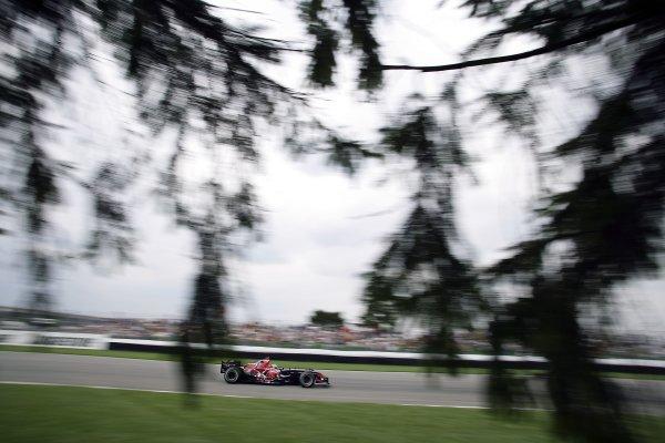 2006 USA Grand Prix - Friday Practice Indianapolis, Indiana, USA. 29th June - 2nd July. Vitantonio Liuzzi, Toro Rosso STR01-Cosworth, action. World Copyright: Charles Coates/LAT Photographic ref: Digital Image ZK5Y6045