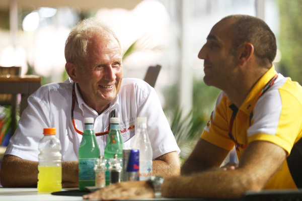 Marina Bay Circuit, Singapore. Saturday 19 September 2015. Helmut Markko, Consultant, Red Bull Racing, with Cyril Abiteboul, Head Engineer, Renault Sport F1. World Copyright: Alastair Staley/LAT Photographic ref: Digital Image _R6T6070