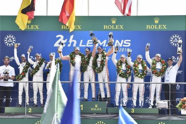 #92 Porsche GT Team Porsche 911 RSR: Michael Christensen, Kevin Estre, Laurens Vanthoor,#91 Porsche GT Team Porsche 911 RSR: Richard Lietz, Gianmaria Bruni, Frédéric Makowiecki, #68 Ford Chip Ganassi Racing Ford GT: Joey Hand, Dirk Müller, Sébastien Bourdais celebrate the GTLM class win on the podium