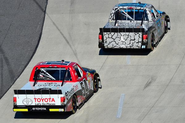 October 25-26, 2013, Martinsville, Virginia USA Denny Hamlin and Darrell Wallace Jr trucks © 2013, Brian Czobat LAT Photo USA