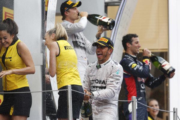 Circuit de Catalunya, Barcelona, Spain. Sunday 11 May 2014. Lewis Hamilton celebrates on the podium. World Copyright: Charles Coates/LAT Photographic. ref: Digital Image _J5R4433