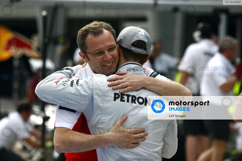 Sepang, Kuala Lumpur, Malaysia1st April 2010Michael Schumacher, Mercedes GP W01, with Stefano Domenicali, Team Principal, Ferrari. Portrait. World Copyright: Charles Coates/LAT Photographicref: Digital Image _26Y8907