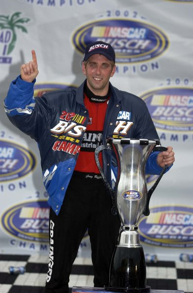2002 NASCAR Miami, USA November 14-17,2002,Homestead-Miami Motorsports Complex-Greg Biffle poses with the championship trophy,-Robt LeSieur2002LAT Photographic