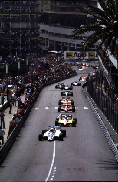 1982 Monaco Grand Prix.Monte Carlo, Monaco.20-23 May 1982.Riccardo Patrese (Brabham BT49D-Ford Cosworth) leads at the start. He finished in 1st position despite spinning in the closing laps.World Copyright - LAT Photographic