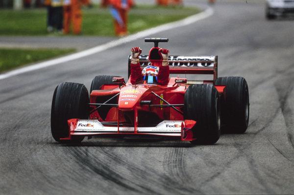 Michael Schumacher, Ferrari F1-2000, celebrates in his cockpit on his way to Parc Ferme.