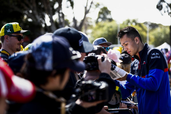 Alexander Albon, Scuderia Toro Rosso signs an autograph for a fan