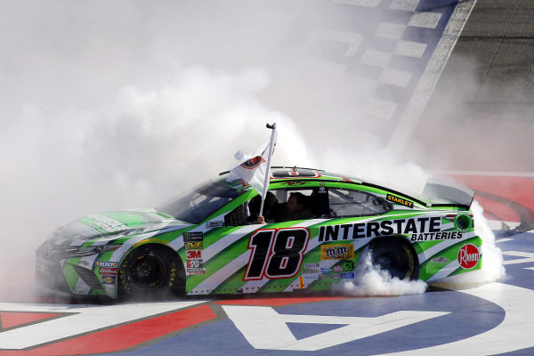 #18: Kyle Busch, Joe Gibbs Racing, Toyota Camry Interstate Batteries celebrates his win with a burnout