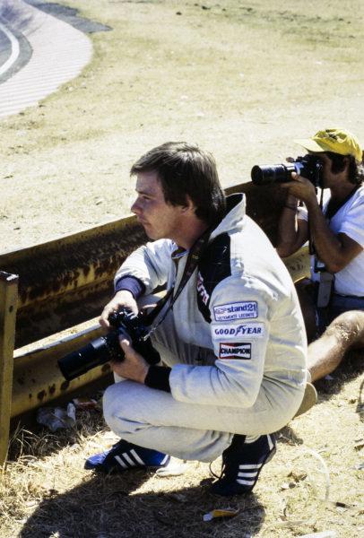 Didier Pironi taking photos trackside.