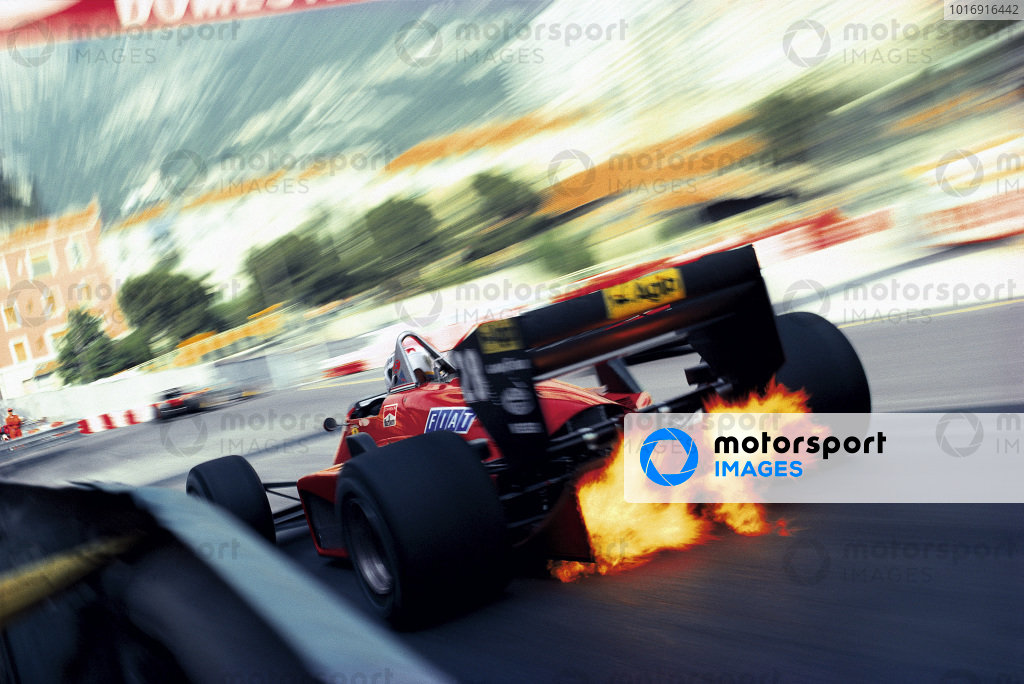 Exhaust flames shoot up through the diffuser of Stefan Johansson's Ferrari 156/85 as he exits Rascasse corner.