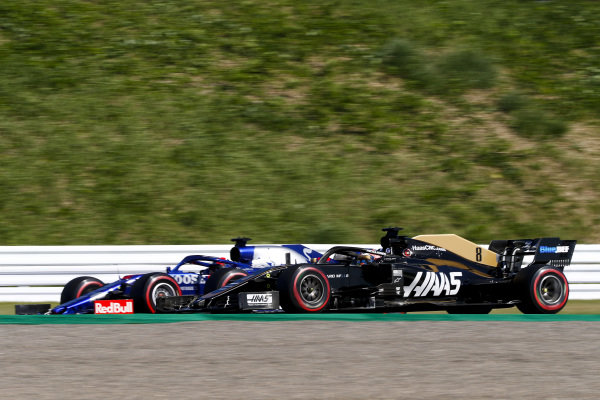 Romain Grosjean, Haas VF-19 and Daniil Kvyat, Toro Rosso STR14