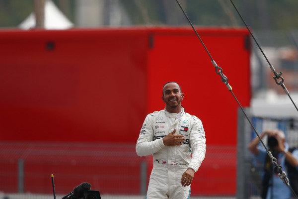 Lewis Hamilton, Mercedes AMG F1, celebrates victory in parc ferme.