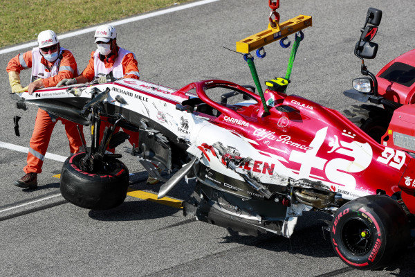 Car of Antonio Giovinazzi, Alfa Romeo Racing C39 being recovered by marshals after crashing