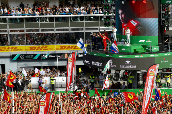 Charles Leclerc, Ferrari, 1st position, arrives on the podium to cheers from fans