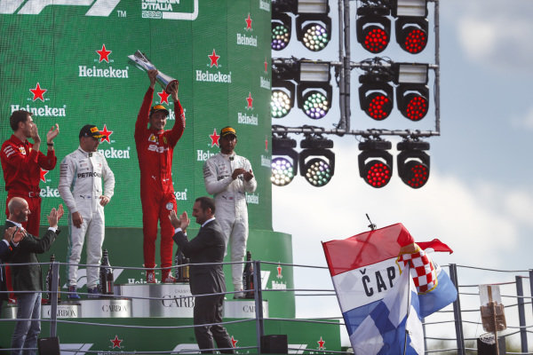 Bp, Race winner Charles Leclerc, Ferrari and Lewis Hamilton, Mercedes AMG F1 celebrate on the odium with the trophy