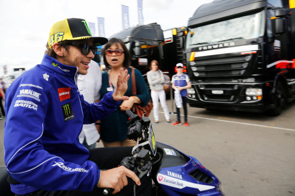 2015 MotoGP Championship.  British Grand Prix.  Silverstone, England. 28th - 30th August 2015.  A woman gasps as she's passed by Valentino Rossi, Yamaha, in the paddock.  Ref: KW5_4502a. World copyright: Kevin Wood/LAT Photographic