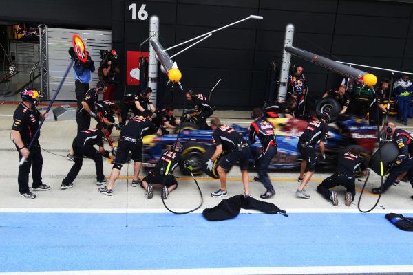 Sebastian Vettel (GER) Red Bull Racing RB8 makes a pit stop. Formula One World Championship, Rd9, British Grand Prix, Qualifying, Silverstone, England, Saturday 7 July 2012.