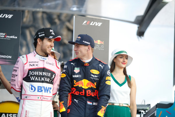 London, United Kingdom.  Wednesday 12 July 2017. Sergio Perez, Force India, and Max Verstappen, Red Bull. World Copyright: Joe Portlock/LAT Images  ref: Digital Image _L5R8734