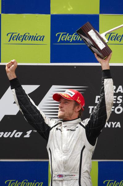 Circuit de Catalunya, Barcelona, Spain 10th May 2009 Jenson Button, Brawn GP BGP001 Mercedes, 1st position, celebrates victory on the podium. Portrait. Podium.  World Copyright: Steve Etherington/LAT Photographic ref: Digital Image SNE13955