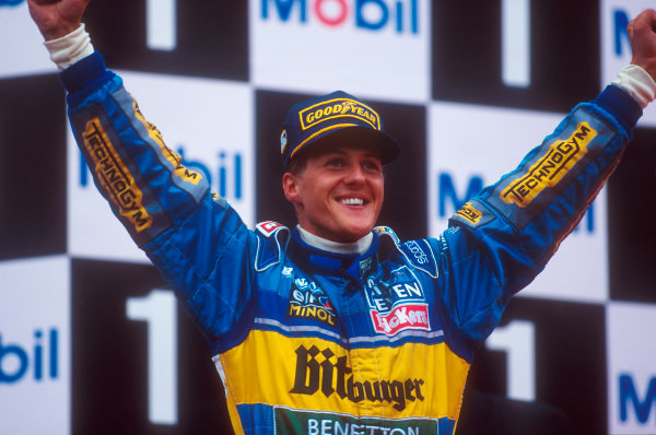 Spa-Francorchamps, Belgium.25-27 August 1995.Michael Schumacher (Benetton Renault) celebrates 1st position on the podium.Ref-95 BEL 05.World Copyright - LAT Photographic