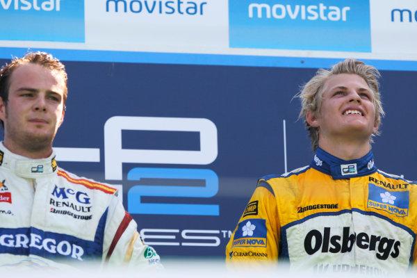 Valencia Spain. 27th June. Sunday Race. Marcus Ericsson (SWE, Super Nova Racing) celebrates his victory on the podium with Giedo Van der Garde (NED, Barwa Addax Team). Portrait. Photo: Andrew Ferraro/GP2 Media Service. Ref: _O9T4576 jpg