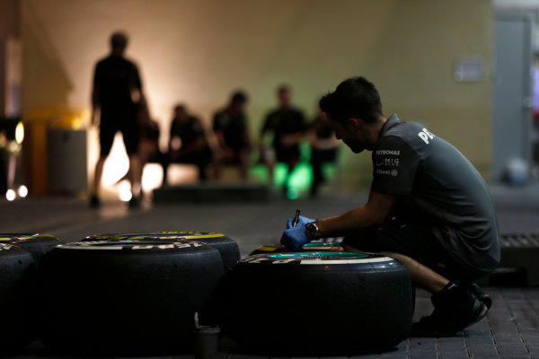 Yas Marina Circuit, Abu Dhabi, United Arab Emirates. Friday 1st November 2013. A Mercedes AMG at work on tyres in the paddock. World Copyright: Charles Coates/LAT Photographic. ref: Digital Image _N7T0555