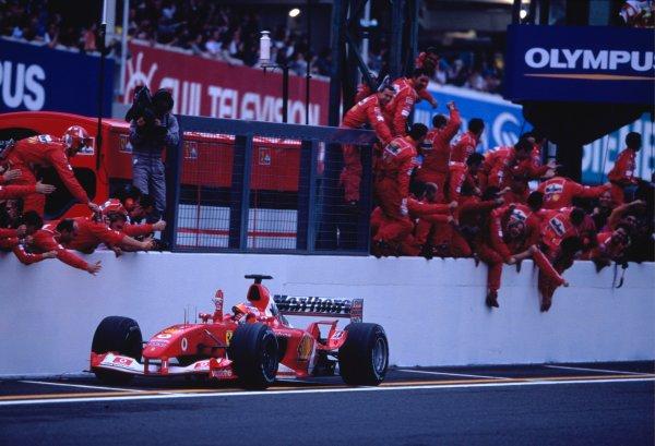 2003 Japanese Grand PrixSuzuka, Japan. 10th - 112th October 2003.Race winner Rubens Barrichello, Ferrari F2003 GA, crosses the finish line.World Copyright: Charles Coates / LAT Photographic ref: 35mm Image 03JAP01