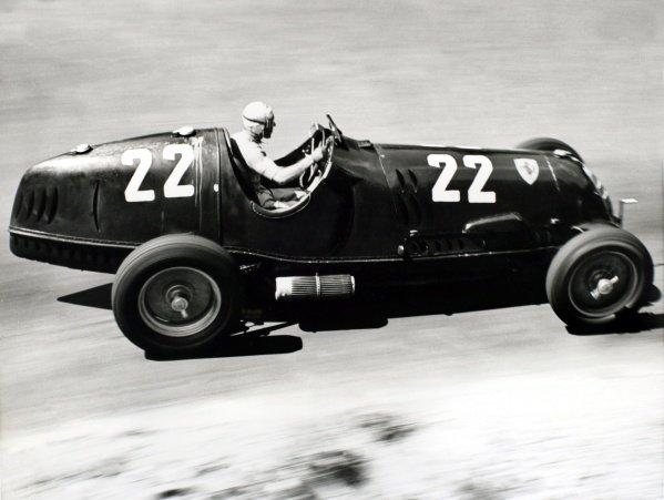 1937 German Grand Prix. Nurburgring, Germany. 25 July 1937. Tazio Nuvolari, Alfa Romeo 12C, 4th position, action. World Copyright: Robert Fellowes/LAT Photographic Ref: RF37_GER_51