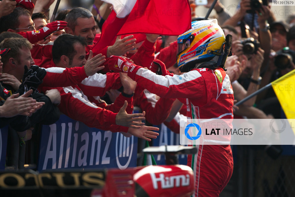 Shanghai International Circuit, Shanghai, China Sunday 14th April 2013 Fernando Alonso, Ferrari, 1st position, celebrates with his team upon arrival in Parc Ferme. World Copyright: Andy Hone/LAT Photographic ref: Digital Image HONZ7737