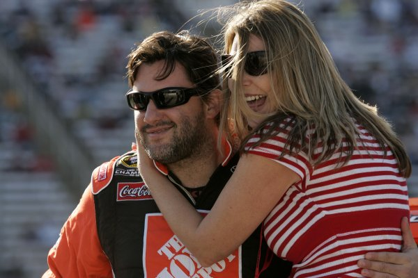 4-6 April, 2008, Fort Worth, Texas USA. Tony Stewart is hugged by a fan. 2008, LAT South USALAT Photographic