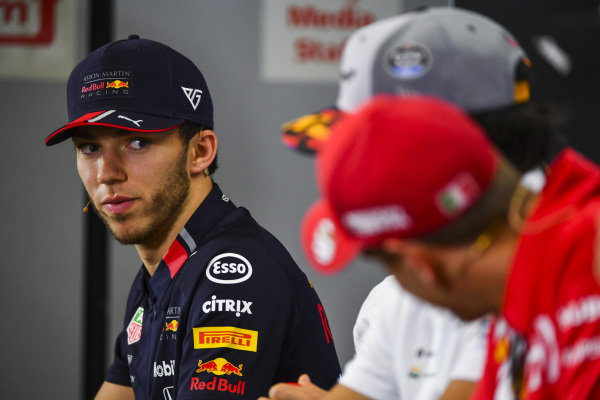 Pierre Gasly, Red Bull Racing and Sebastian Vettel, Ferrari speak during the Press Conference