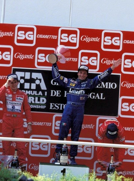 Ayrton Senna, 2nd position, Riccardo Patrese, 1st position, and Jean Alesi, 3rd position, on the podium.