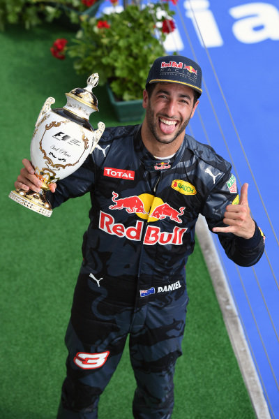 Daniel Ricciardo (AUS) Red Bull Racing celebrates on the podium with the trophy at Formula One World Championship, Rd11, Hungarian Grand Prix, Race, Hungaroring, Hungary, Sunday 24 July 2016.