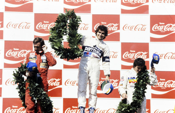 Nelson Piquet, 1st position, on the podium with Carlos Reutemann, 2nd position, and Alain Prost, 3rd position.