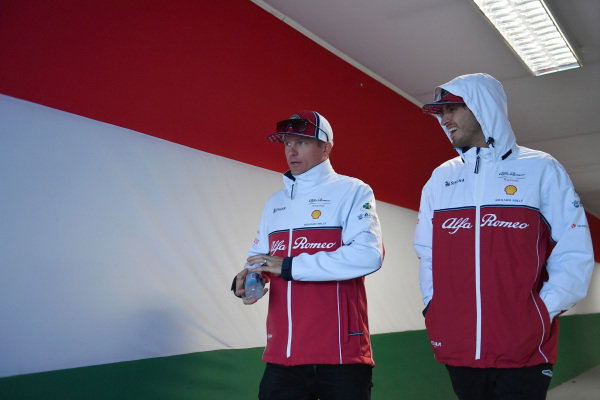 Kimi Raikkonen, Alfa Romeo Racing, and Antonio Giovinazzi, Alfa Romeo Racing