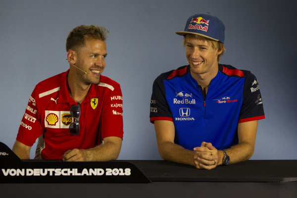 Sebastian Vettel (GER) Ferrari and Pierre Gasly (FRA) Scuderia Toro Rosso in the Press Conference