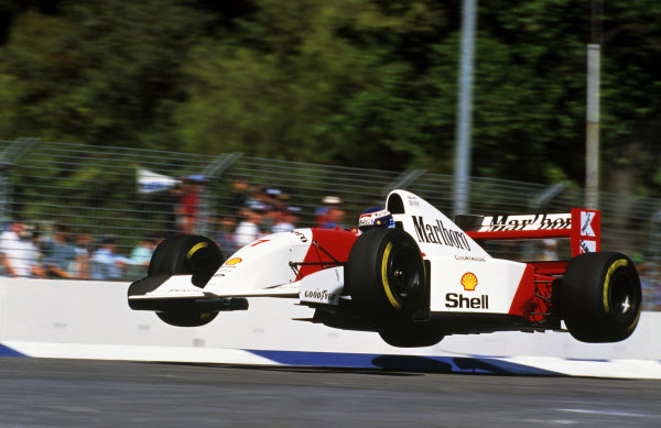 The Flying Finn Mika Hakkinen launches his McLaren MP4/8 into the air at the Malthouse Corner during a lap in practice.
