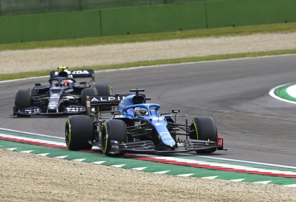 Fernando Alonso, Alpine A521, leads Pierre Gasly, AlphaTauri AT02