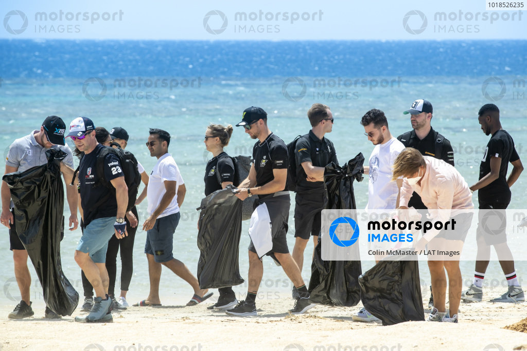 The drivers undertake a litter collection on the beach