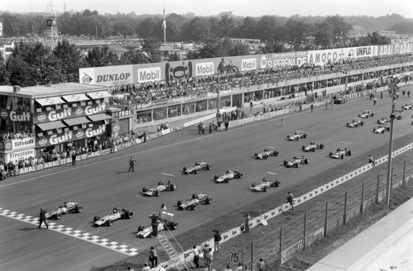 John Surtees, Honda RA301, lines up on pole position with Bruce McLaren, McLaren M7A Ford, and Chris Amon, Ferrari 312, alongside as the field wait for the starting flag to wave.