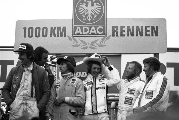 1975 Nurburgring 1000 kms. Nurburgring, Germany. 1st June 1975. Rd 7. L to R: Howden Ganley / Tim Schenken (Mirage Gulf GR7 Ford), 2nd position, Jacques Laffite / Arturo Merzario (Alfa Romeo T33/TT/12), 1st position and Leo Kinnunen / Herbert Muller (Porsche 908/3-6 Turbo), 3rd position, podium, portrait.  World Copyright: LAT Photographic.  Ref: 7530 - 32.
