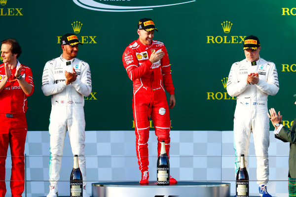 Albert Park, Melbourne, Australia. Sunday 26 March 2017. Race winner Sebastian Vettel, Ferrari SF70H, on the podium, between Lewis Hamilton, Mercedes AMG and Valtteri Bottas, Mercedes AMG.  World Copyright: Sam Bloxham/LAT Images ref: Digital Image _J6I5081
