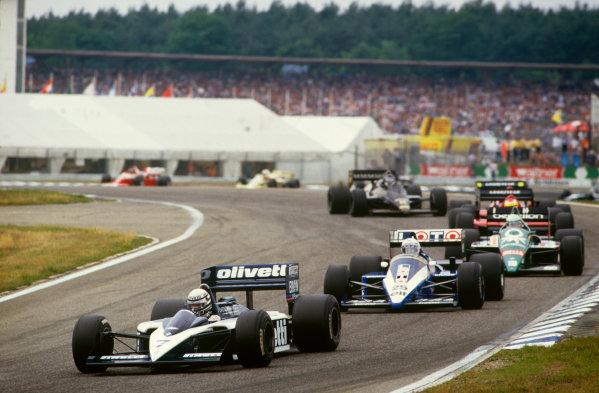 Hockenheim, Germany. 25-27 July 1986.Riccardo Patrese (Brabham BT55-BMW), retired, leads Rene Arnoux (Ligier JS27-Renault), 4th position, action. World Copyright: LAT Photographic.Ref:  86GER