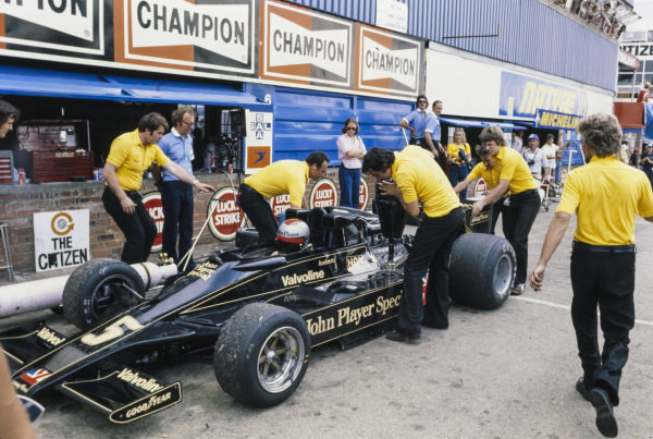 Mario Andretti gets his Lotus 78 Ford refuelled in the pitlane.