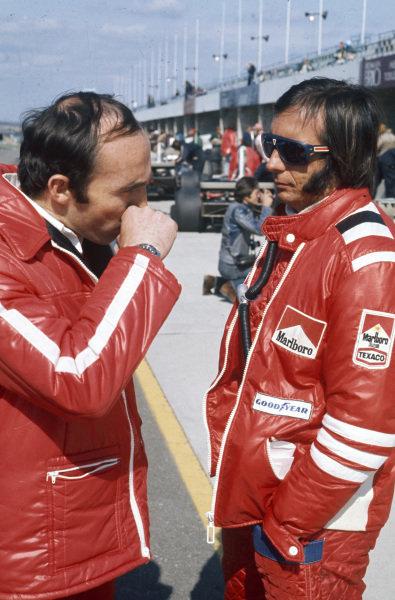 Emerson Fittipaldi talks with Frank Williams.