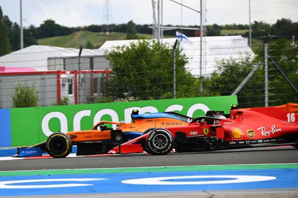 Lando Norris, McLaren MCL35, battles with Charles Leclerc, Ferrari SF1000