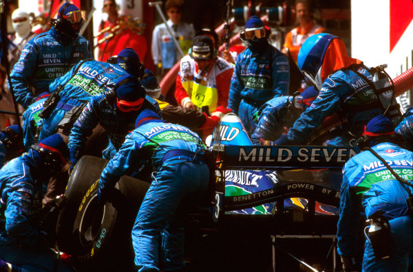 Imola, Italy.3-5 May 1996.The Benetton crew tend to Jean Alesi at a pitstop.Ref-96 SM 22.World Copyright - LAT Photographic