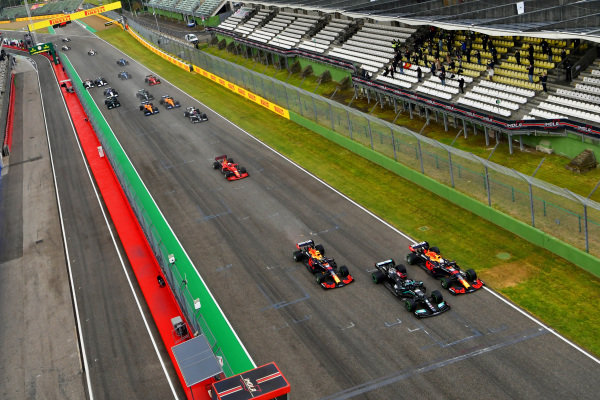 Sir Lewis Hamilton, Mercedes W12, leads Max Verstappen, Red Bull Racing RB16B, Sergio Perez, Red Bull Racing RB16B, and the rest of the field at the start