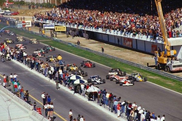 1984 Portuguese Grand Prix.Estoril, Portugal.19-21 October 1984.Alain Prost (McLaren MP4\2 TAG Porsche) leads Keke Rosberg (Williams FW09B Honda), Nelson Piquet (Brabham BT53 BMW), Ayrton Senna (Toleman TG184 Hart), Nigel Mansell and Elio de Angelis (both Lotus 95T Renault's) at the start.Ref-84 POR 06.World Copyright - LAT Photographic