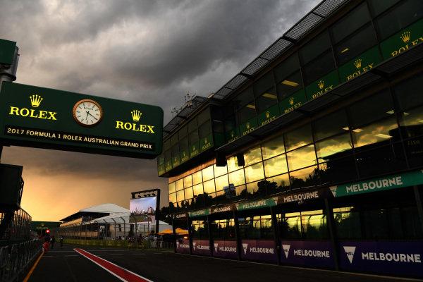 Sunset in pit lane at Formula One World Championship, Rd1, Australian Grand Prix, Qualifying, Albert Park, Melbourne, Australia, Saturday 25 March 2017. BEST IMAGE