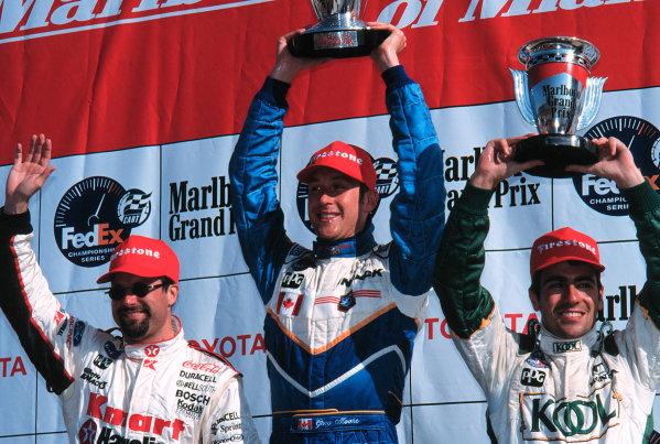 1999 CART MIAMI GP, 21-3-99, Homestead, FL, USAAndretti, Moore and Franchitti celebrate1999, Michael L. Levitt / LAT Photographic